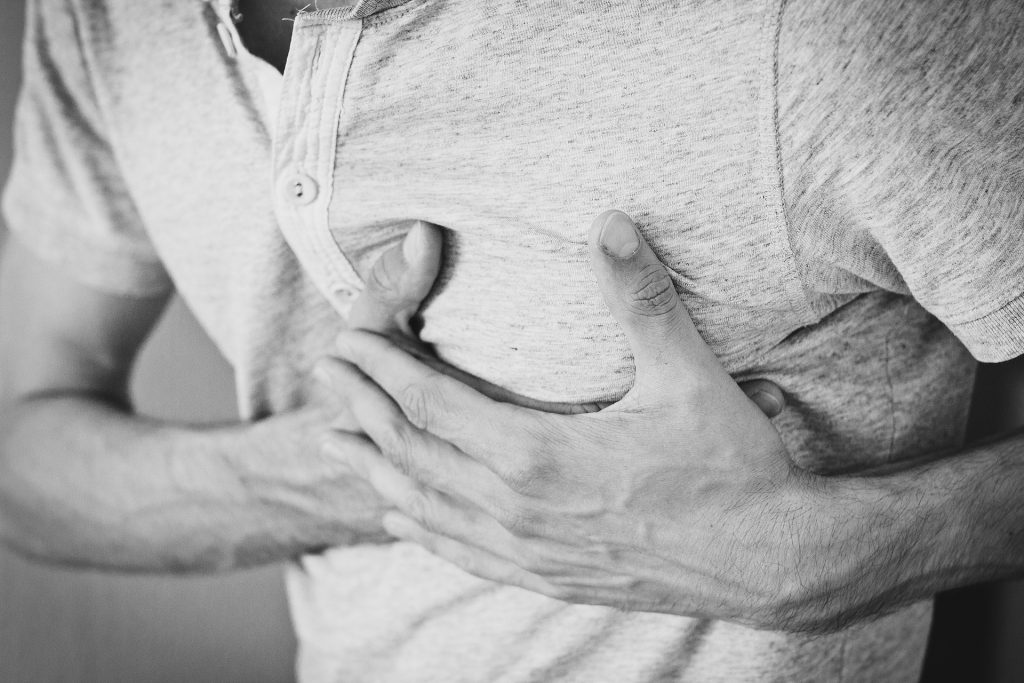 man clutching chest - why everyone should know cpr