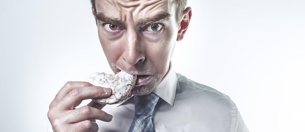 man eating donut